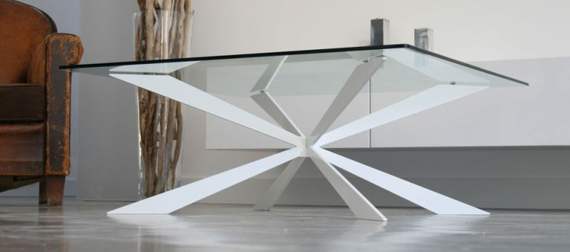 Clix coffee table poses as a sculptural furniture piece for Table basse design verre trempe