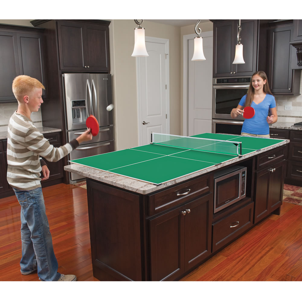 The kitchen table tennis accommodates a multitude of games - How much space for a ping pong table ...
