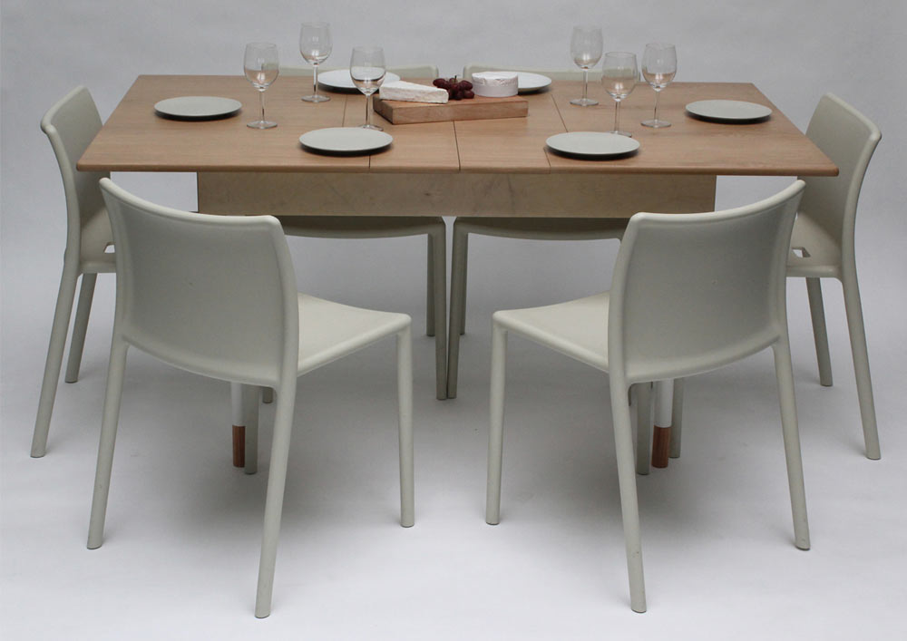 table for two doubles as a workstation for two and dining table