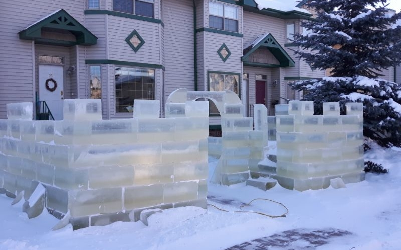 Alberta dad builds playful ice castle in front yard for his little kids