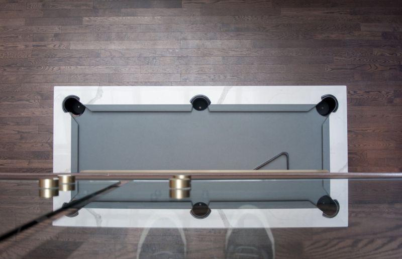 HWG pool tbale by Daniel Finkelstein is a bespoke centerpiece for the luxury hotel