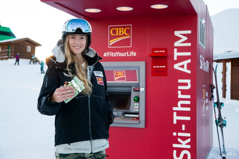 World Champion & Olympic Gold Medalist Ashley McIvor experiences banking at her ski tips with CIBC's new ski-thru ATM at the top of Whistler Mountain at Whistler Blackcomb Ski Resort. (CNW Group/CIBC)
