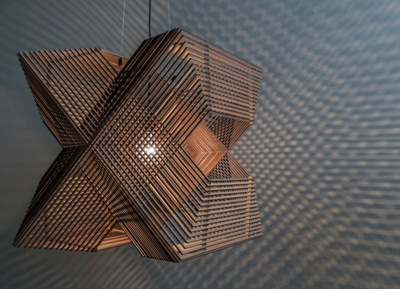 The Angles pendant lamp is elegant fusion of laser-cut wooden rectangles