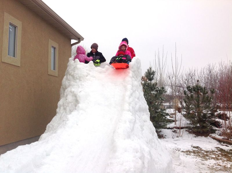 Utah dad builds 300-feet backyard luge run for his kids
