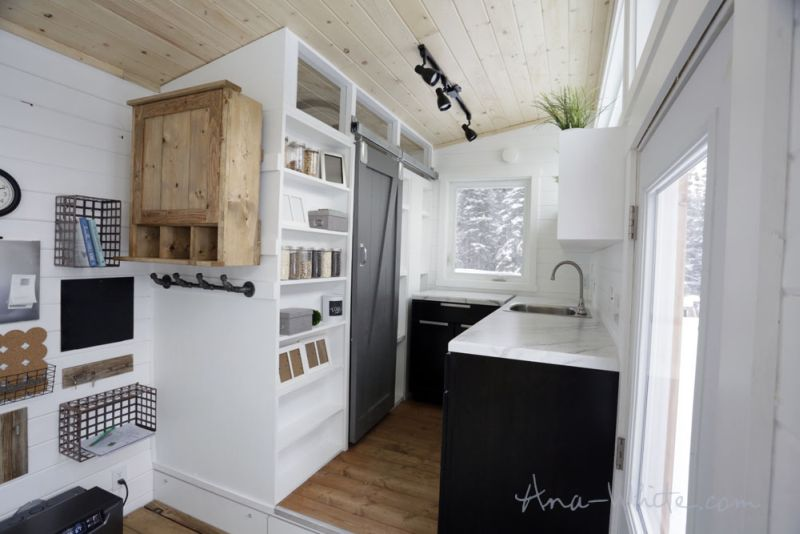 Ana White's open concept tiny house features elevator bed to save space