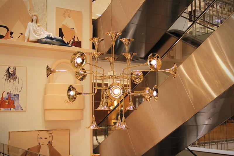 Botti Chandelier by Delightfull consists of multiple trumpet bells