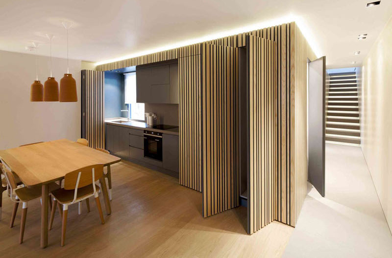 This apartment in maida vale hides kitchen inside a larch - Puertas correderas bauhaus ...