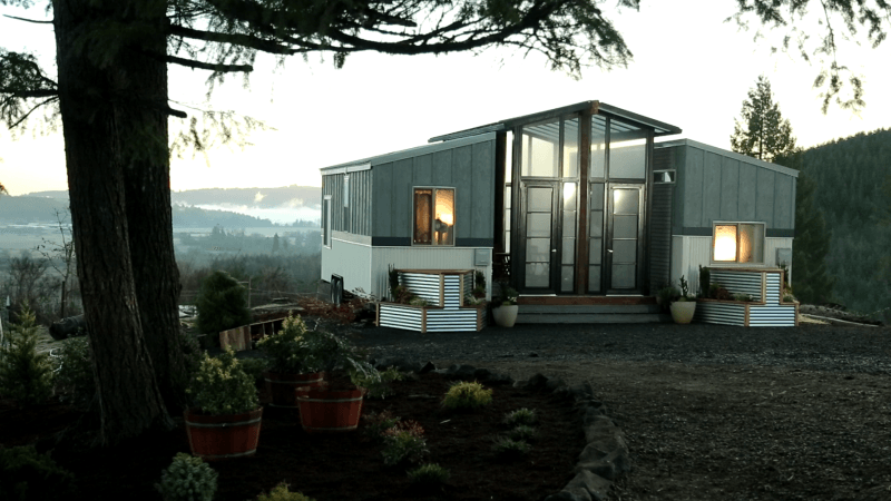 Ohana tiny house features a patio between two trailers