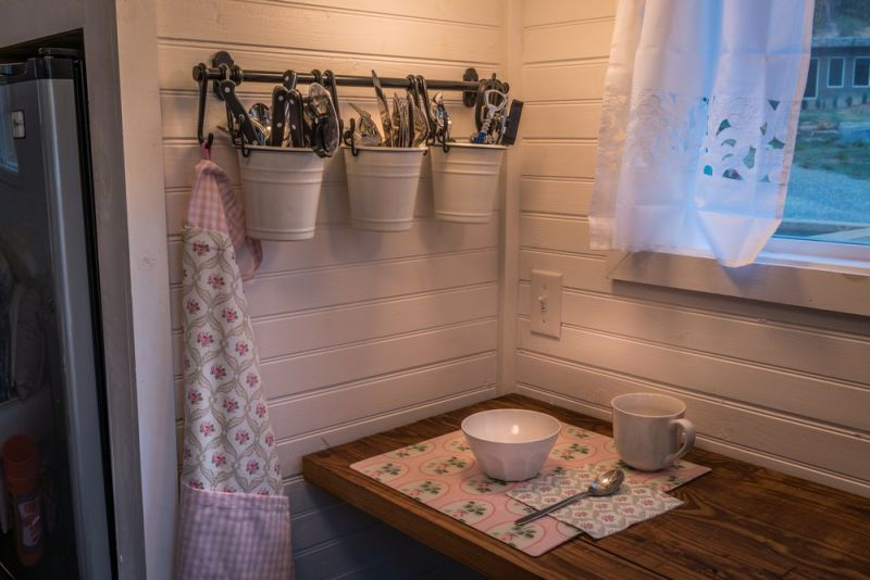 Old Blue Chair Tiny House has cozy reading nook under the staircase