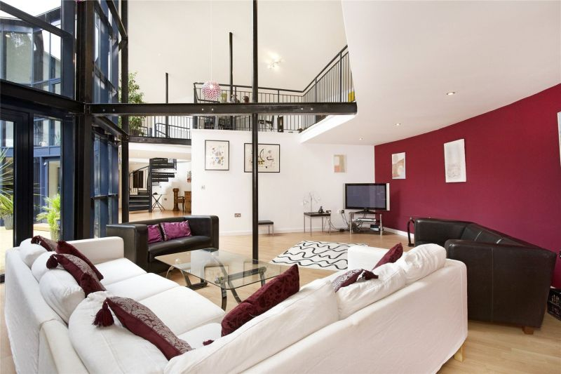 Old water reservoir transformed into an underground family home