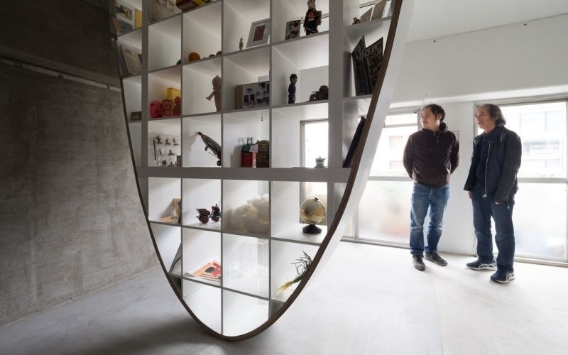 These unique parabolic shelves hang from the ceiling