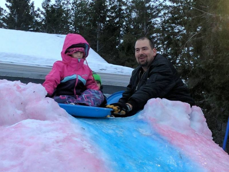 This snaking ice slide by Tracadie dad is colorful attraction for the entire neighborhood