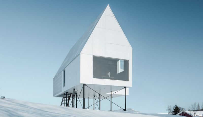 All-white High House by Delordinaire blends well with snowy slopes