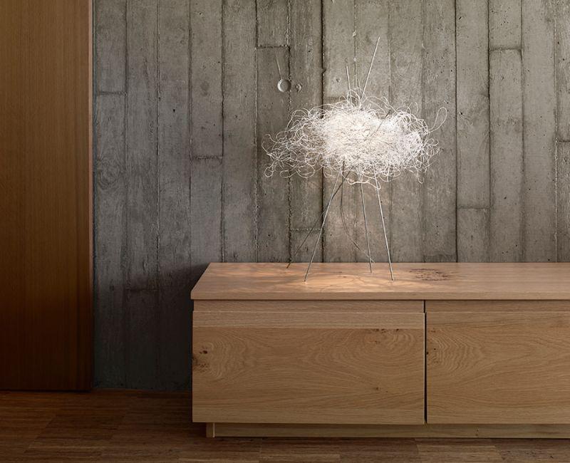 Pili lamp collection by Arturo Alvarez looks like an illuminating bird's nest