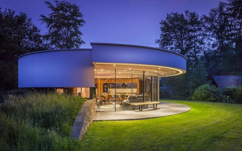 This circular house with big windows brings the outdoors inside