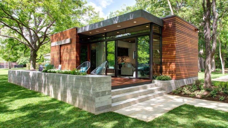 Un box studio designs rustic lakeside cabin at austin for Lakeside designs