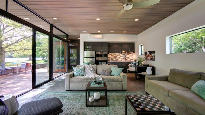 Un.Box Studio designs rustic lakeside cabin at Austin