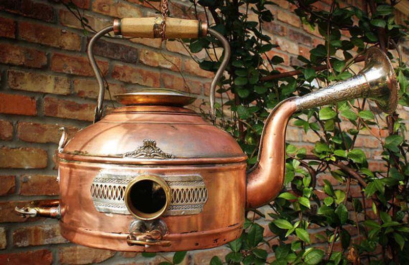 Bird home crafted from vintage copper kettle teapot and clock