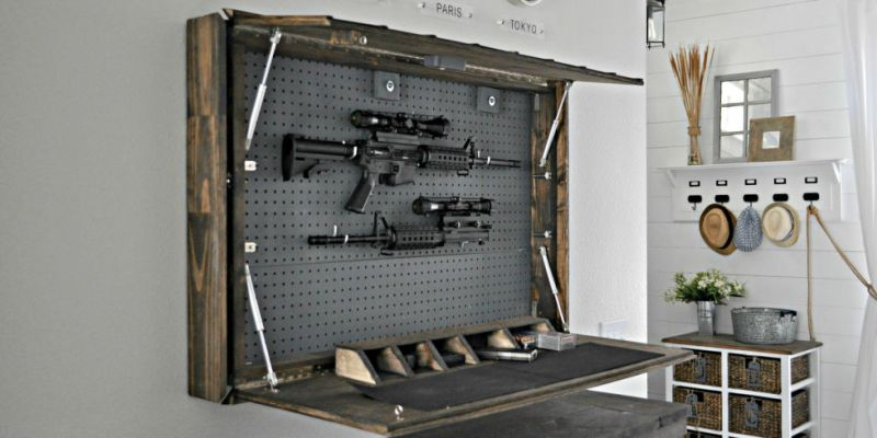 bed with secret gun safe in its headboard