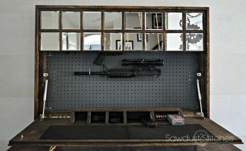 Gun concealment behind a mirror