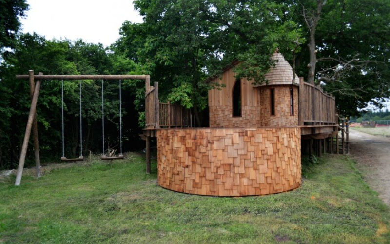 Nook treehouse features sunken fire pit in the middle of amphitheatre seating