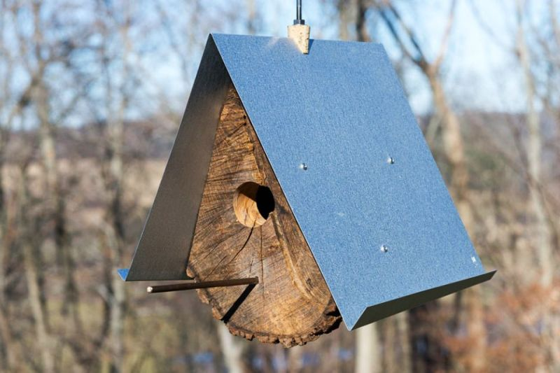 Rustic log quartered birdhouse