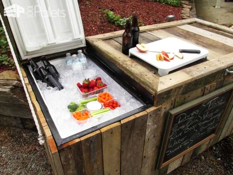 A rustic cooler from broken refrigerator and pallets