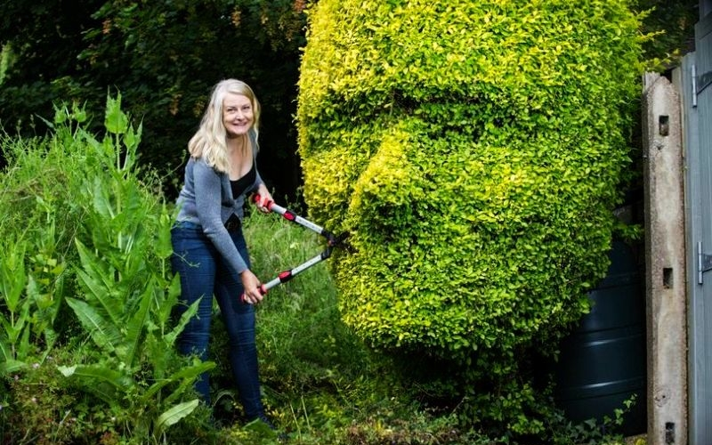 Birmingham mom carves her son and partner's faces into garden hedges
