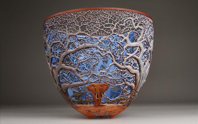Artist recreates intricate Kenyan wildlife scenes on wooden bowls