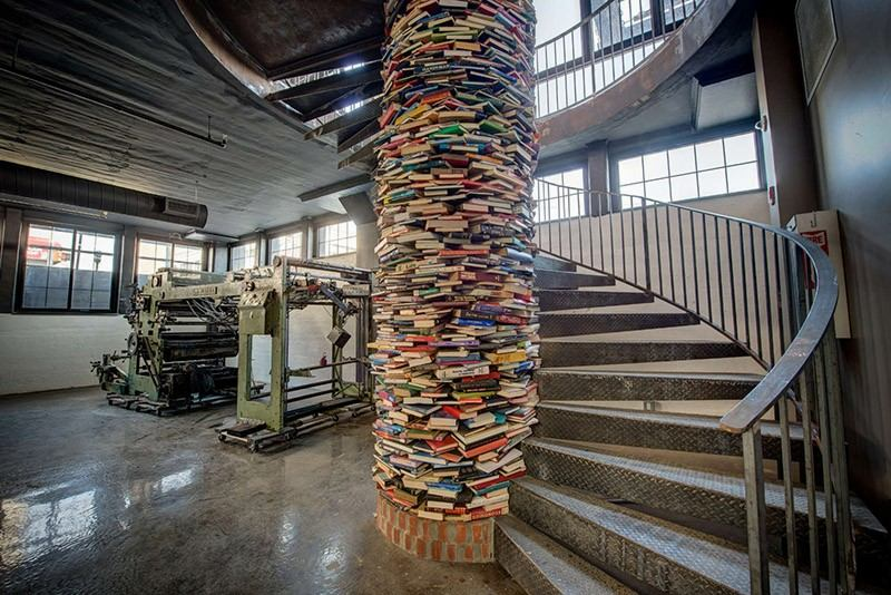 Staircase with column wrapped in books