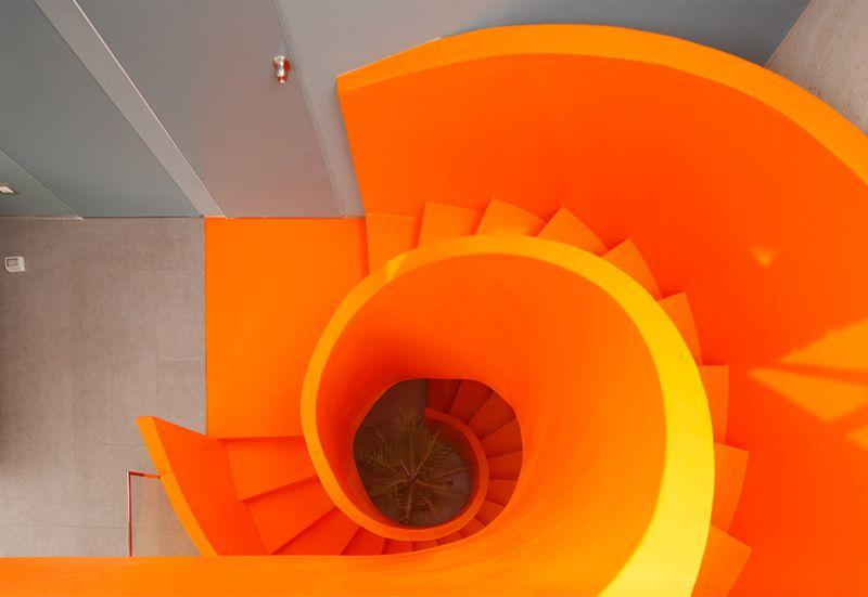 Contemporary orange spiral staircase