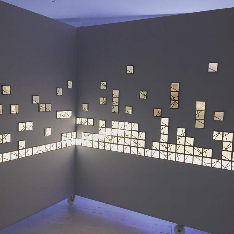 Kumiko modular OLED wall tiles function as lighted wall art