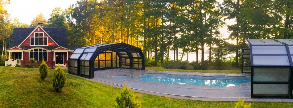 Libart's retractable swimming pool enclosure for a house in picturesque Casco Bay