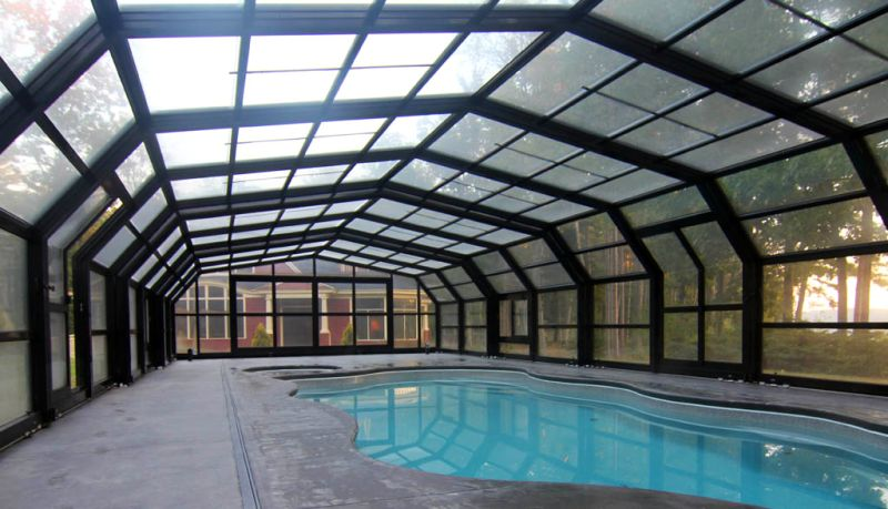 Libart retractable swimming pool roof for a house in picturesque Casco Bay