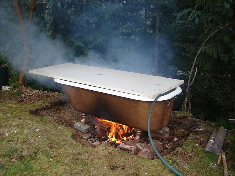 Old bathtub into hot tub