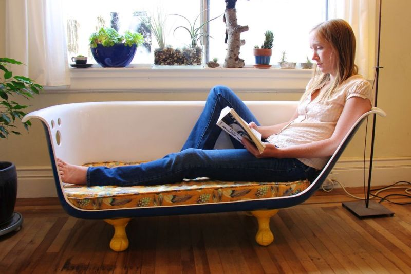 Old bathtub repurposed into sofa