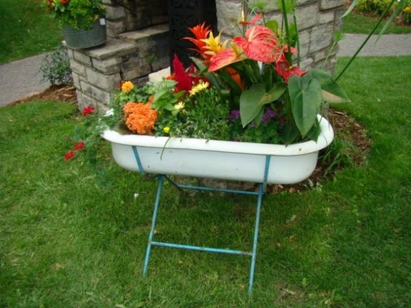 Old baby bathtub into planter