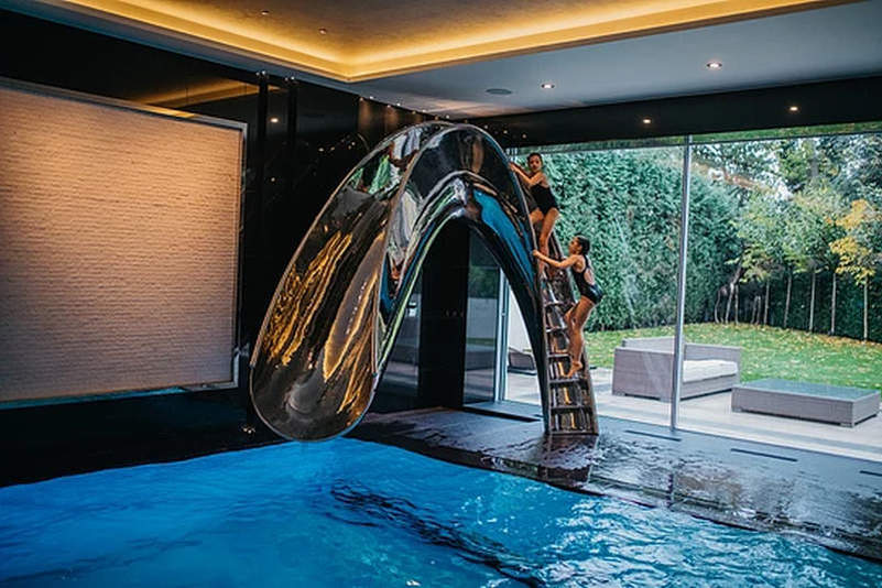 splinterworks sculptural pool slides bring unlimited fun to your home - House Pools With Slides