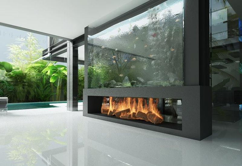 This architectural fish tank that sits inside the Glass House by Razvan  Barsan + Partners and Wigwam Design WIGWAM design doubles as a fireplace.