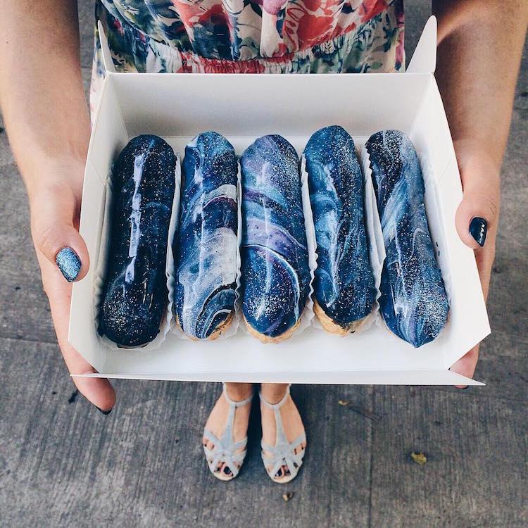 Galaxy-inspired Eclairs in various shades of blue, purple and pink