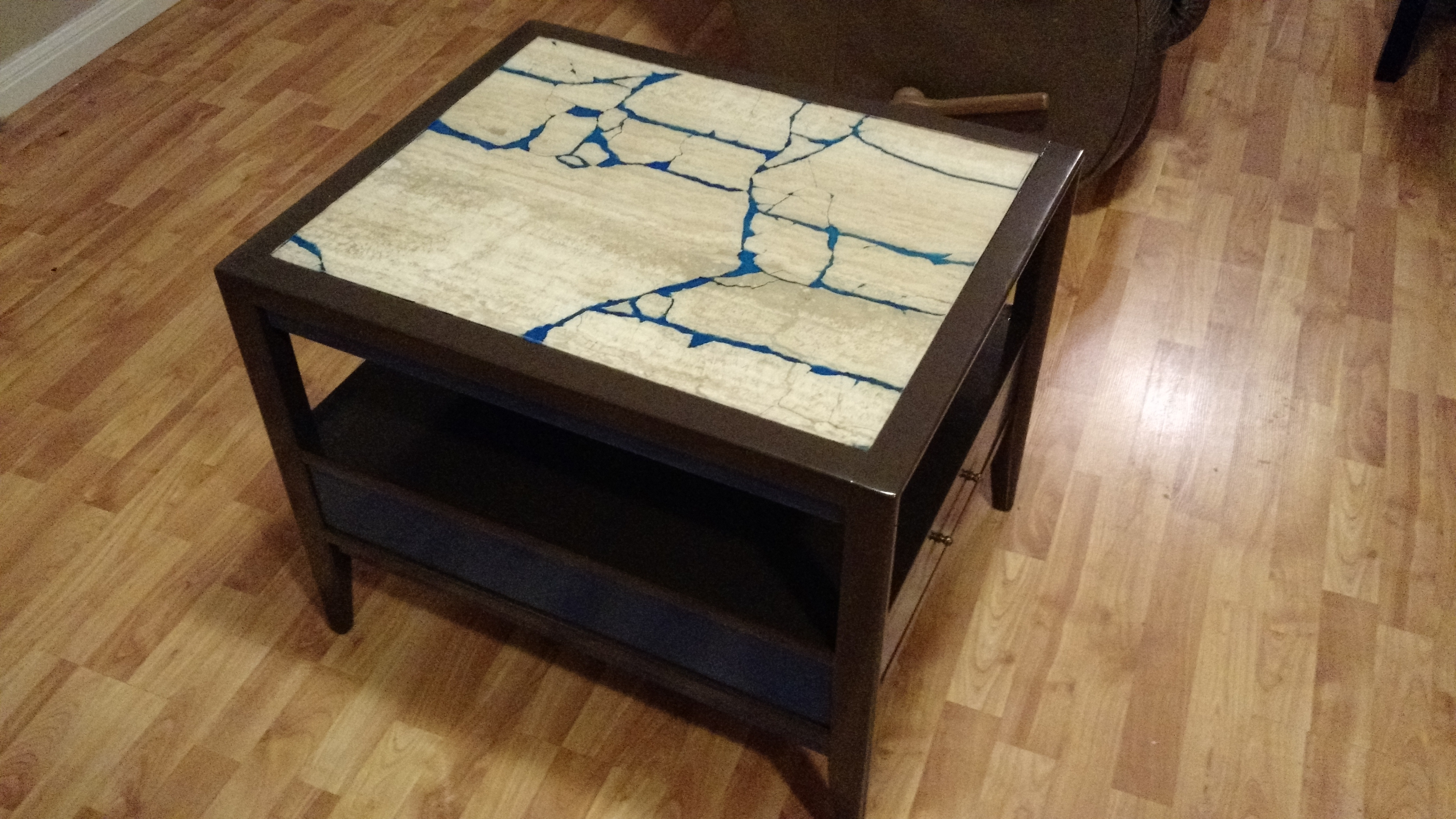 Refurbished glow in the dark marble end table.