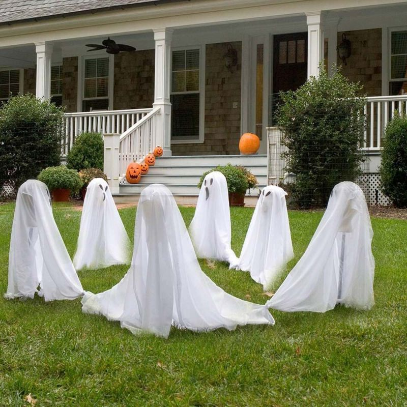 Decorate your backyard with bunch of white sheets for Halloween