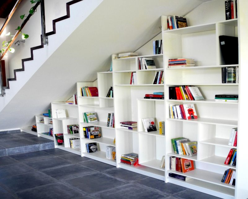 decorate under stair space using books