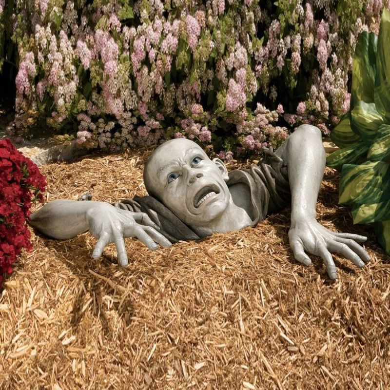 Zombie buried in the garden looks freaky