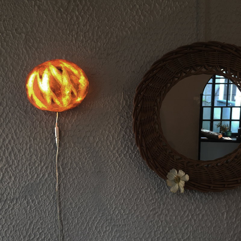Pampshade bread lamp for wall by Yukiko Morita