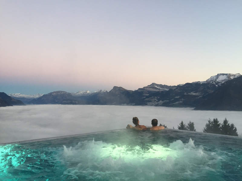 heated infinity pool at hotel villa honegg offers sweeping views of swiss alps homecrux. Black Bedroom Furniture Sets. Home Design Ideas