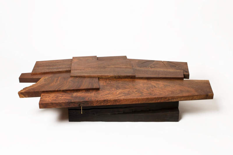 Strike/Slip table by Taylor Donsker can be split into two halves