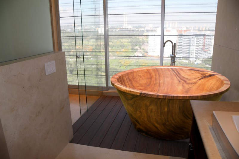 Wood bathtubs by Timber Neutral are carved out of 3 ton tree trunks
