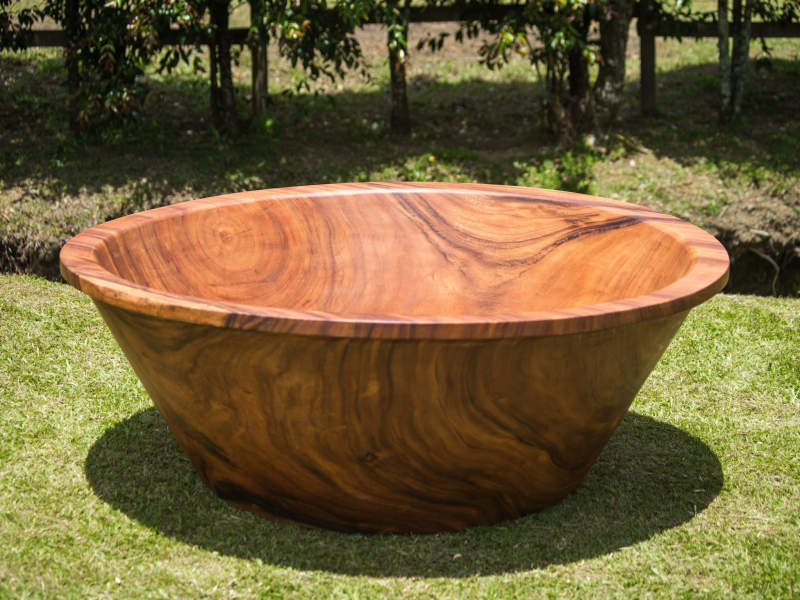 Wood bathtubs by Timber Neutral are carved out of 3 ton tree trunk