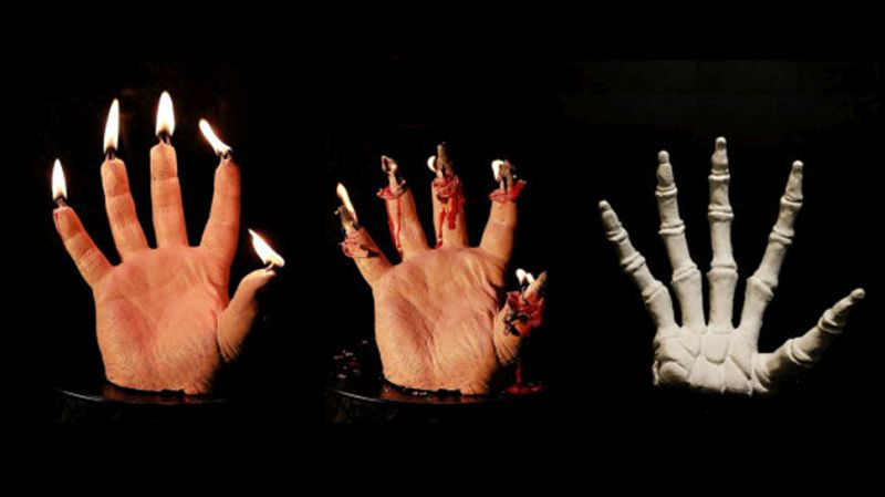 Watch bleeding hand candles melt away to reveal a skeleton hand